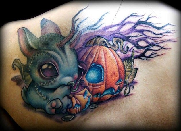 3D like funny cartoon rabbit monster tattoo on back with pumpkin