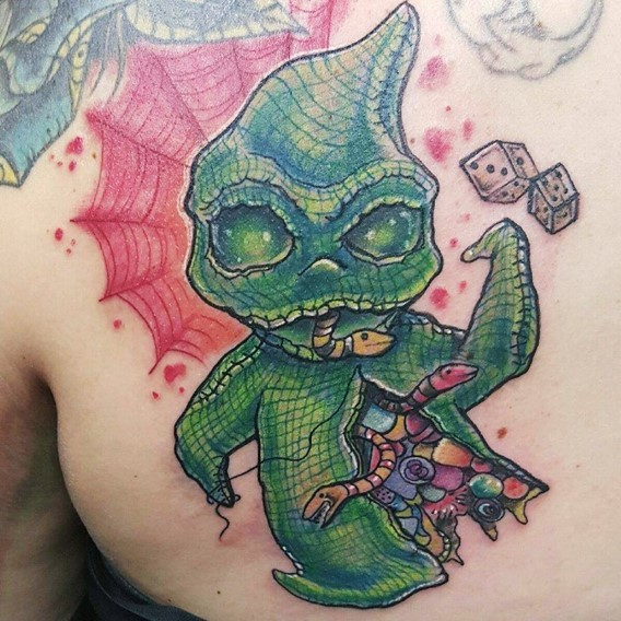 3D like funny monster tattoo on back stylized with snaked and dice