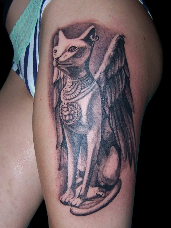 3D like gorgeous black ink thigh tattoo of Egypt cat statue with wings