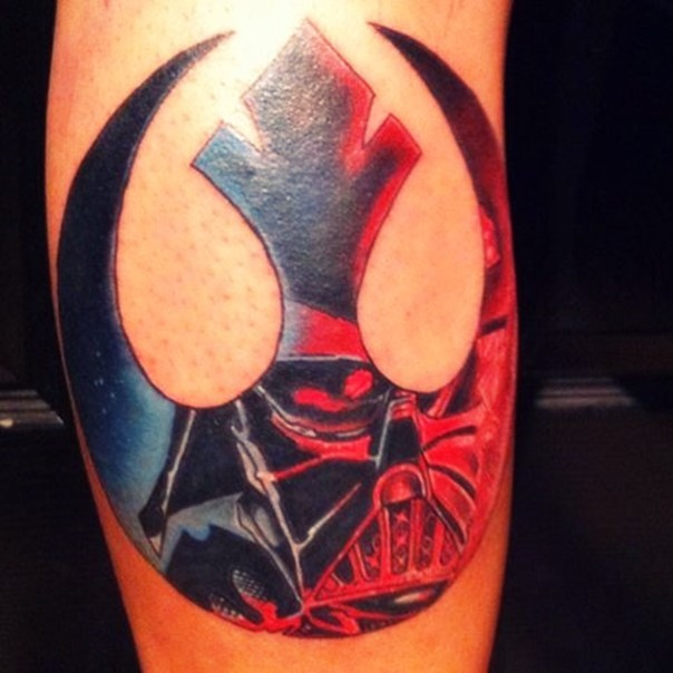 3D like gorgeous colored Rebel emblem tattoo on forearm stylized with Darth Vaders mask