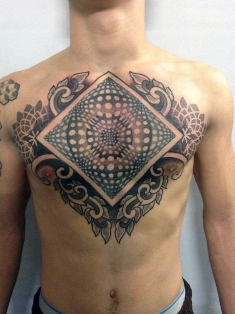 3D like hypnotic colored ornament tattoo on chest