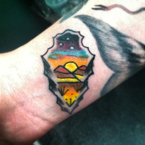 3D like little ancient weapon tattoo stylized with night desert