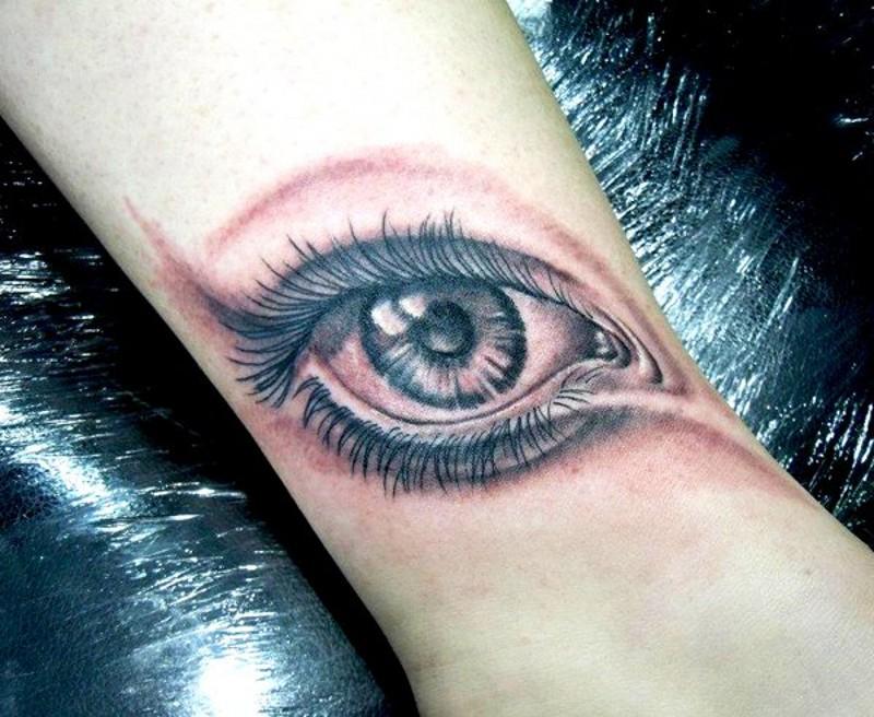3D like little black ink sad eye tattoo on ankle