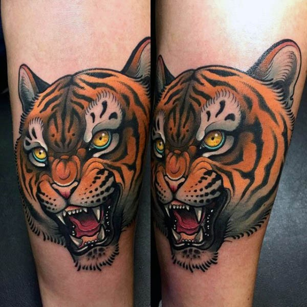 3D like little colorful angry tiger tattoo