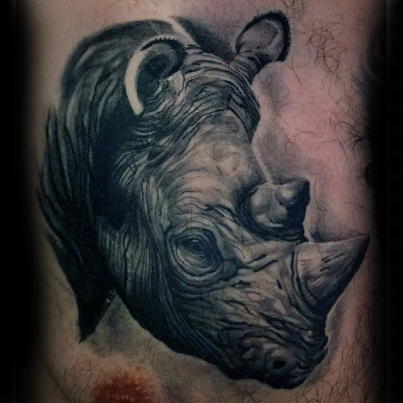 3D like massive black ink very detailed rhino head tattoo on chest