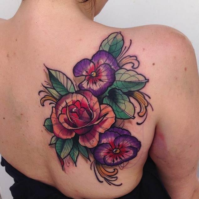 3D like massive multicolored various flowers tattoo on back