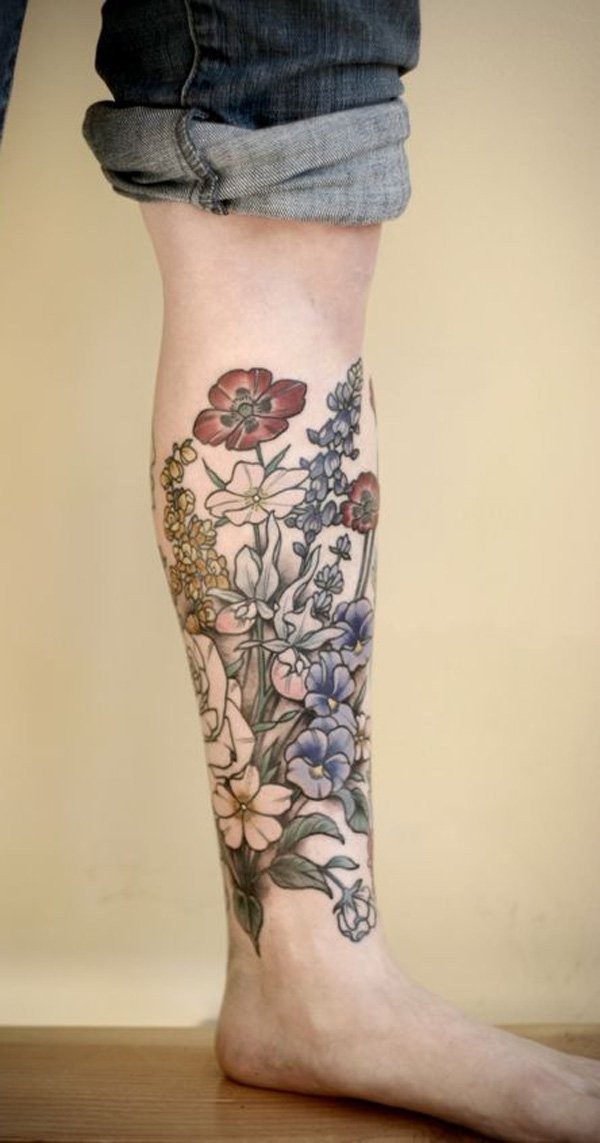 3D like natural colored various flowers on leg tattoo