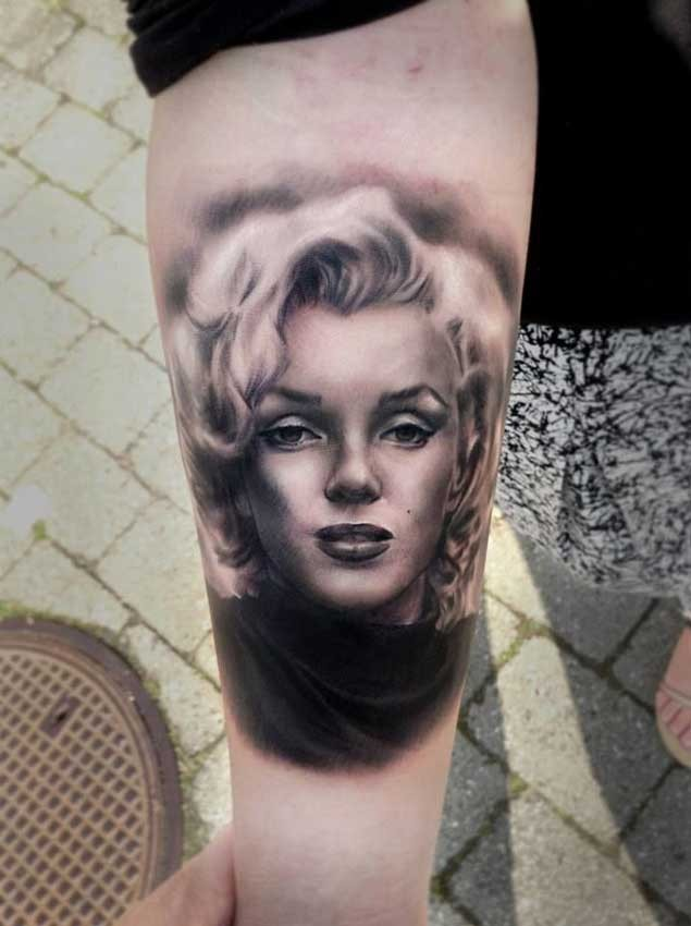 3D like natural looking Merlin Monroe portrait tattoo on arm