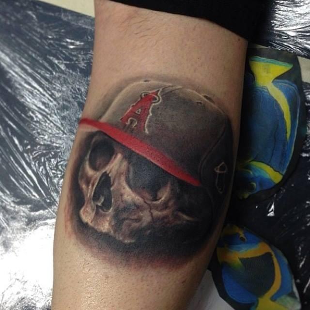 3D like nice colored baseball fan skull tattoo on leg