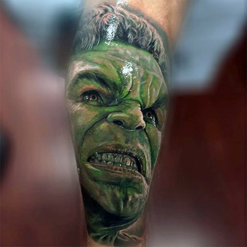 3D like painted detailed looking colored leg tattoo of Hulk face