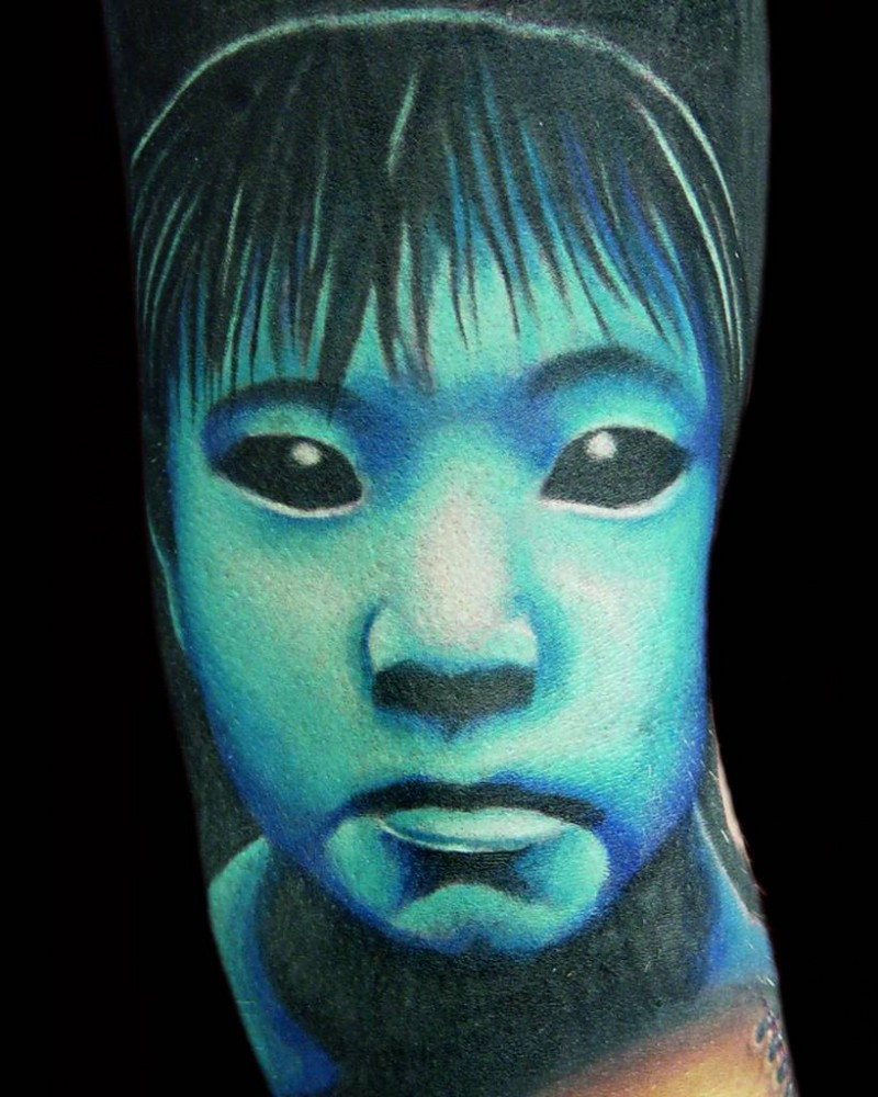 3D like very cool painted and colored creepy horror girl tattoo on arm