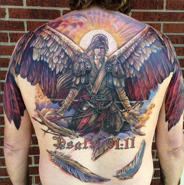 3D like very detailed colored angel warrior tattoo on whole back with lettering