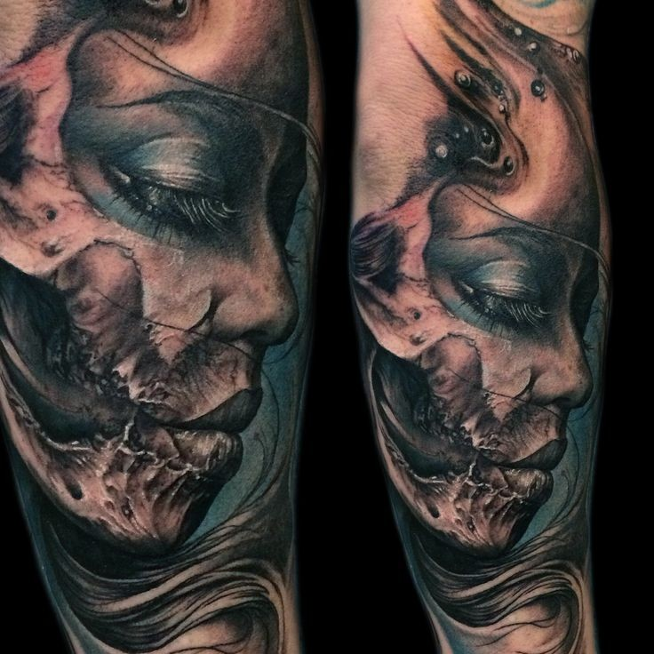 3D like very detailed colored forearm tattoo of demonic woman portrait