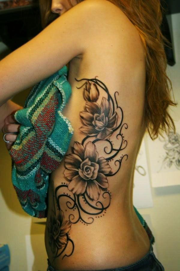 3D like very detailed various flowers tattoo on chest