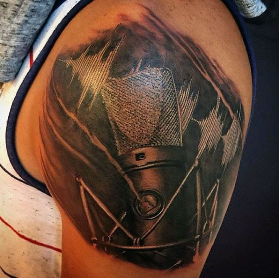 3D like very detailed vintage microphone with music wave tattoo on shoulder
