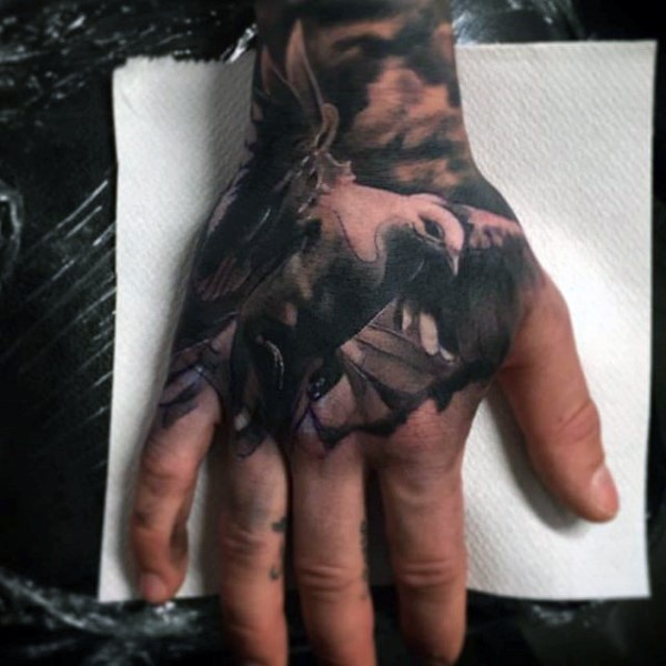 3D like very realistic looking black and white pigeon tattoo on hand