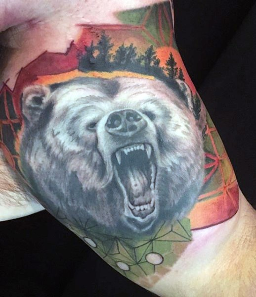 3D like very realistic looking black and white roaring massive bear tattoo on biceps