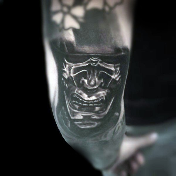 3D natural looking cool samurai mask tattoo on arm