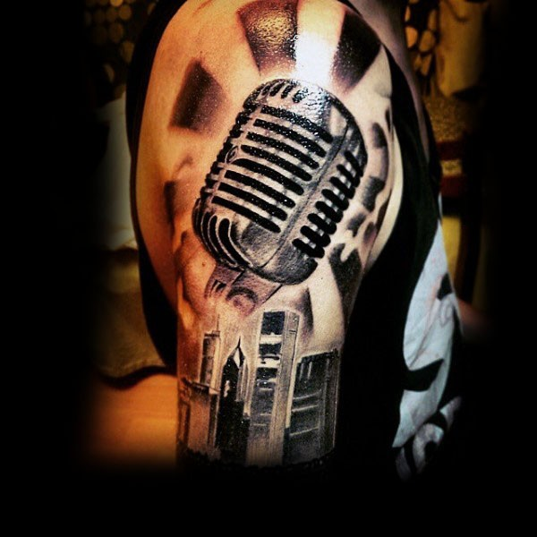 3D realistic black and white vintage microphone tattoo on shoulder