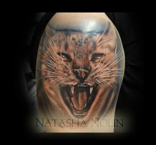 3D realistic colored natural angry cat shoulder tattoo by Natasha Nolin