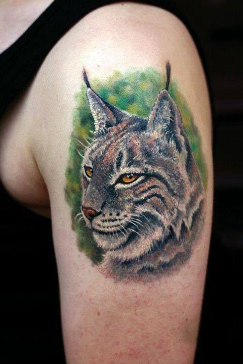 3D realistic colored photo like wild cat tattoo on shoulder