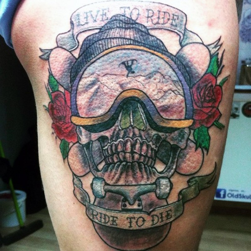 3D realistic extreme themed skull with flowers and lettering tattoo on thigh