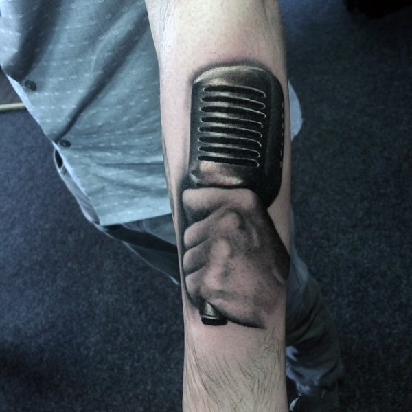 3D realistic hand with old style microphone tattoo on arm