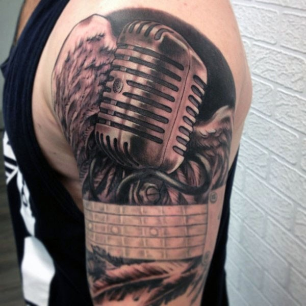3D realistic looking black and white vintage microphone tattoo on shoulder with guitar