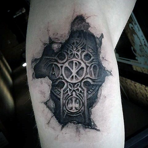 3D realistic looking black and white cross under skin tattoo on arm