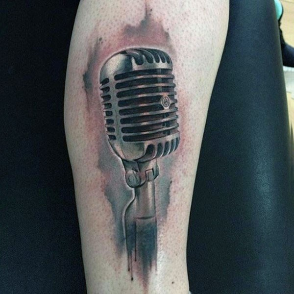 3D realistic looking colored vintage microphone tattoo on leg