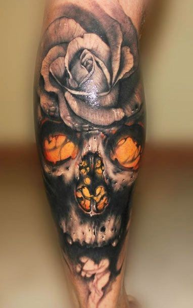 3D realistic painted and detailed big demonic skull with flowers tattoo on arm