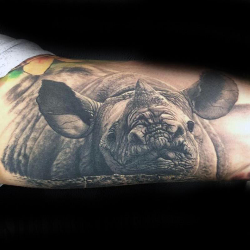 3D realistic photo lifelike wildlife rhinoceros biceps tattoo
