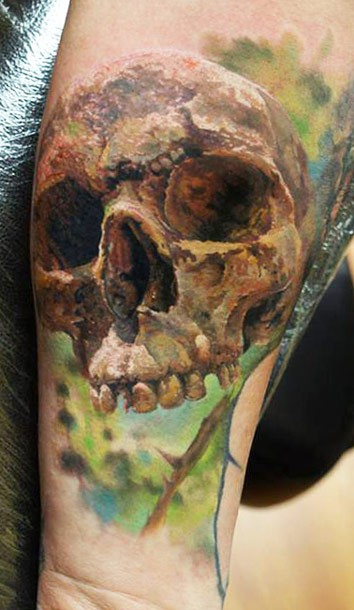 3D realistic photo like colored human skull tattoo on arm