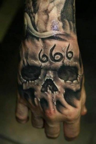 3D realistic very detailed black and white skull with devils number tattoo on hand