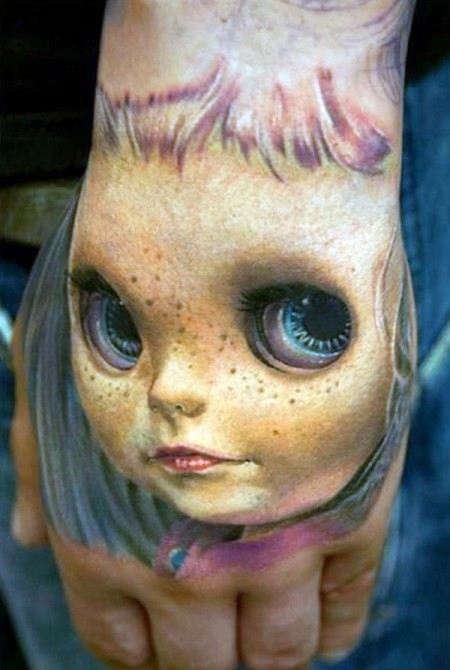 3D realistic very detailed creepy doll tattoo on hand