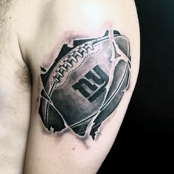 3D style amazing looking shoulder tattoo of American football ball