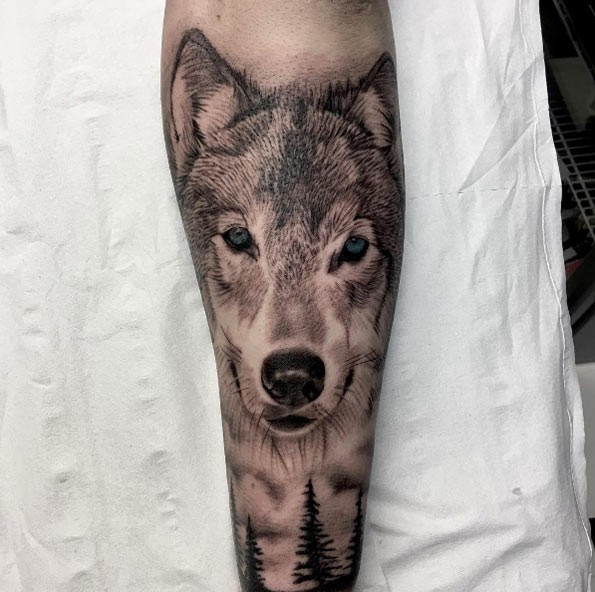 3D style beautiful looking leg tattoo of wolf with blue eyes