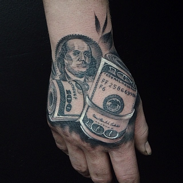 3D style black and white detailed dollar bills rolls tattoo on hand