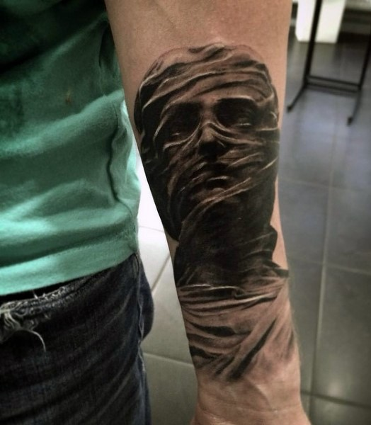 3D style black and white forearm tattoo of mystical statue