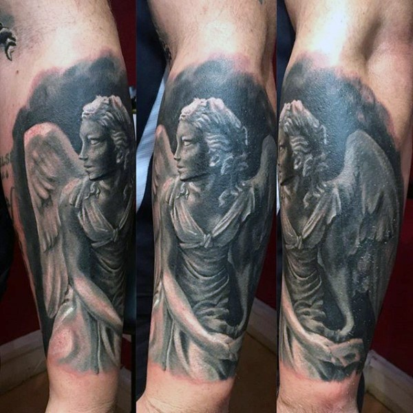 3D style black and white forearm tattoo of angel statue