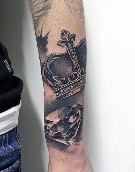 3D style black and white forearm tattoo of diamond with crown