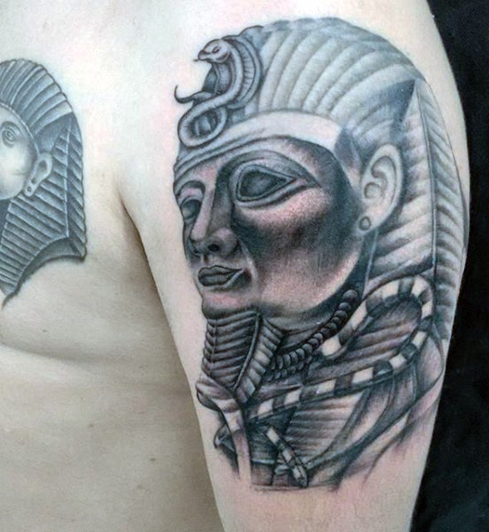3D style black and white shoulder tattoo of Egypt pharaoh statue