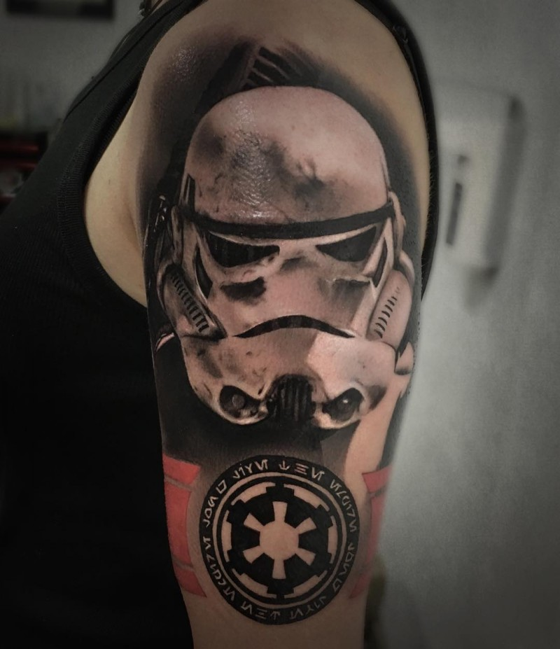3D style black and white shoulder tattoo of Storm troopers helmet with emblem