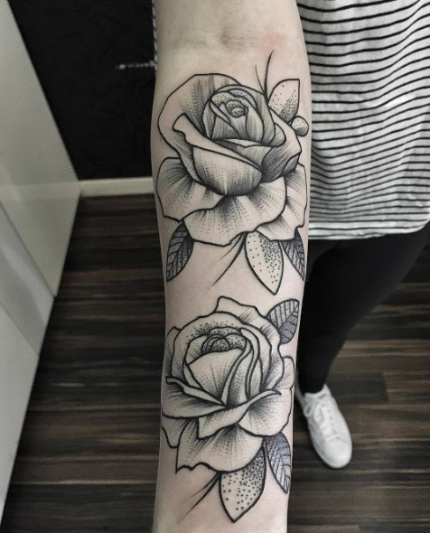 3D style black and white various shaped rose flowers tattoo on the lower part of the arm