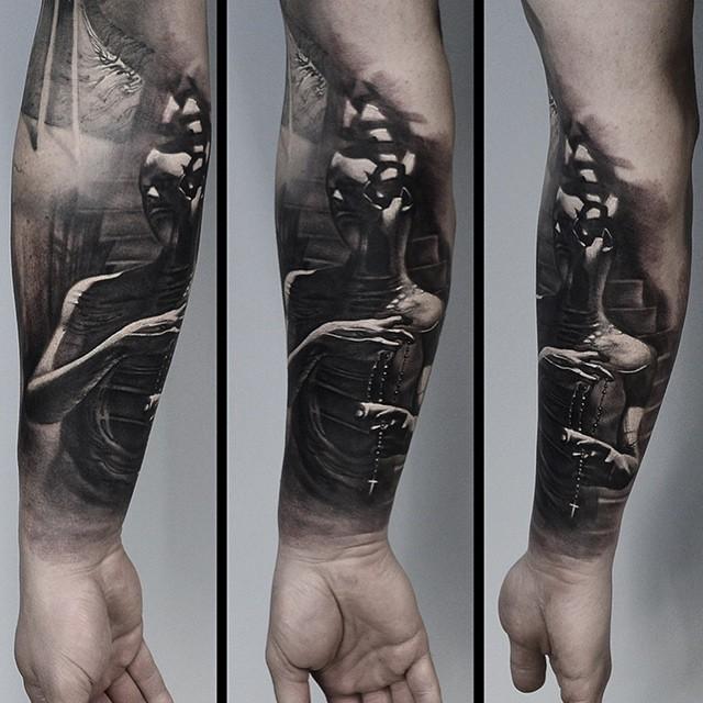 3D style black ink forearm tattoo of creepy human figure