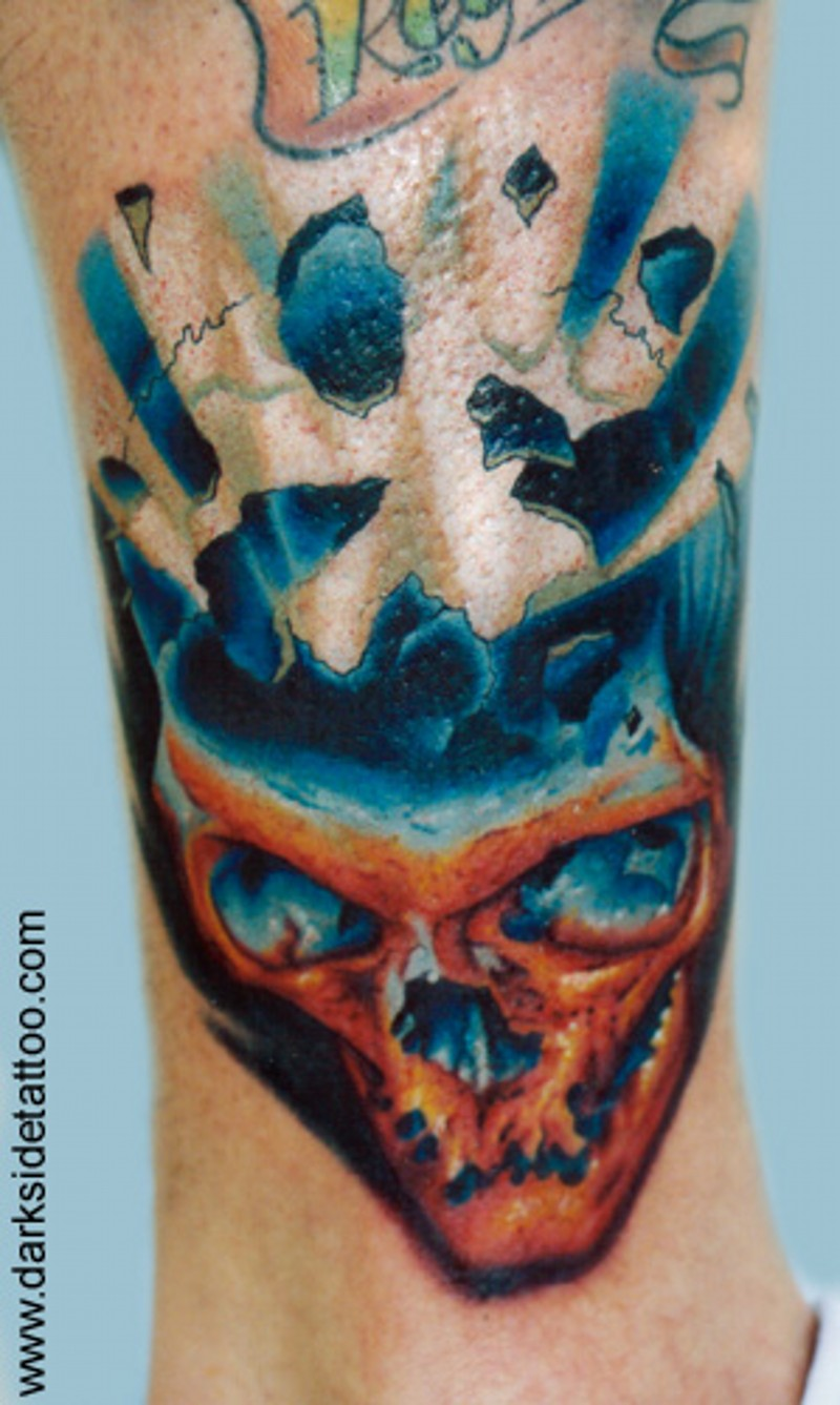 3D style colored ankle tattoo of glowing skull