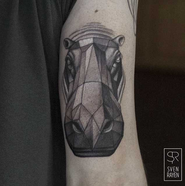 3D style colored arm tattoo of geometrical hippo