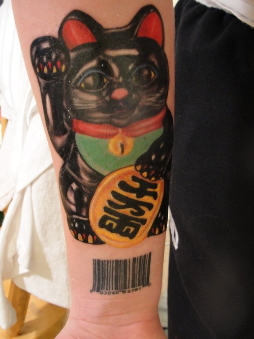 3D style colored arm tattoo of maneki neko japanese lucky cat statuette with barcode