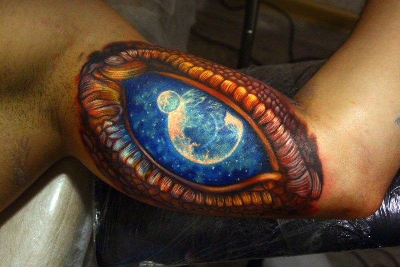 3D style colored biceps tattoo of fantasy eye with space