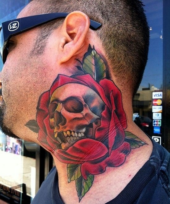 3D style colored big rose flower tattoo on neck stylized with little skull